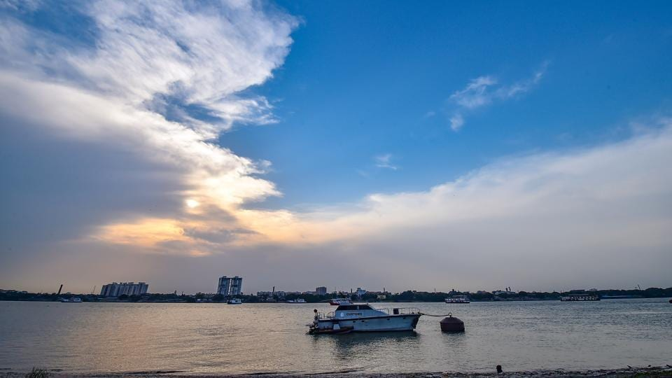 Clouds hover over river Ganga in Kolkata, Saturday, May 16, 2020. The India Meteorological Department on Saturday predicted that the depression in Bay of Bengal is likely to intensify rapidly into a cyclonic storm.