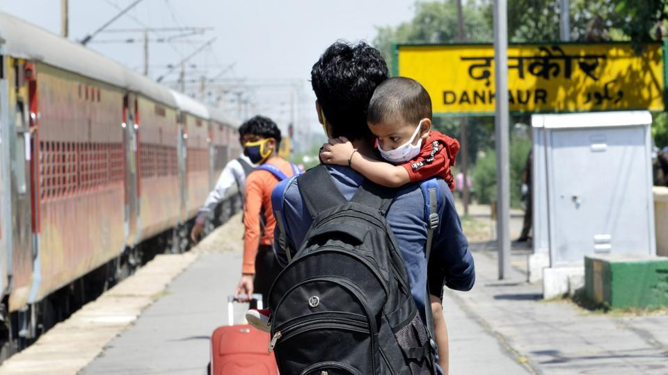 A migrant worker heads to board a special train bound for his home state, Greater Noida, May 16, 2020