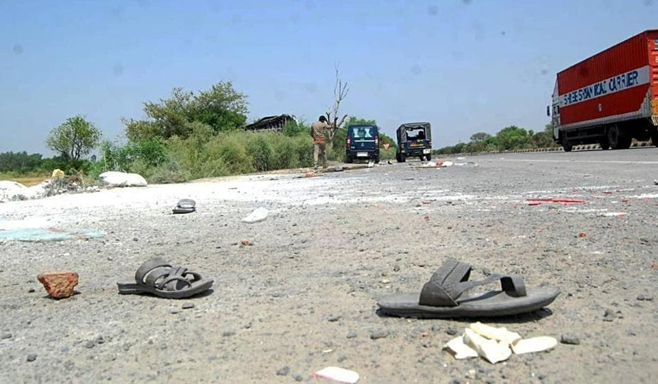 Slippers lying on the road where an accident took place claiming 26 lives of migrant workers near Auraiya district during the lockdown, in Lucknow on May 16.