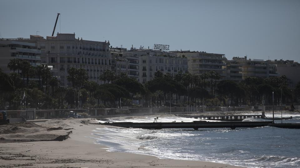 The deserted Croisette beach is pictured empty due to measures put in place to stop the spread of the coronavirus in Cannes, southern France, Tuesday, May 12, 2020. The Cannes Film Festival has been postponed indefinitely.