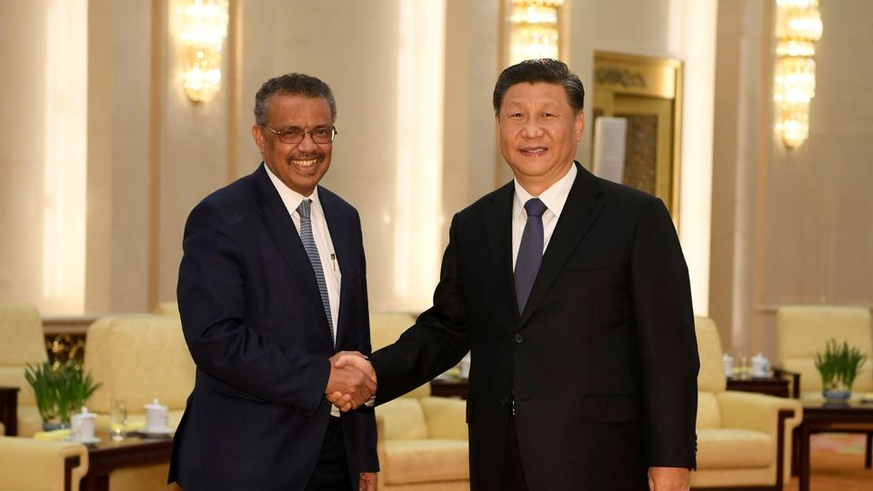 Tedros Adhanom, director general of the World Health Organization, shakes hands with Chinese President Xi jinping before a meeting at the Great Hall of the People in Beijing, China, January 28, 2020.
