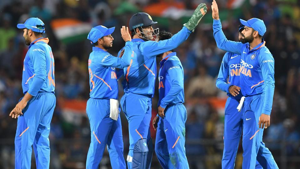 (FILES) In this file photo taken on March 5, 2019, Indian cricket team captain Virat Kohli (R) celebrates with Mahendra Singh Dhoni (C) and teammates