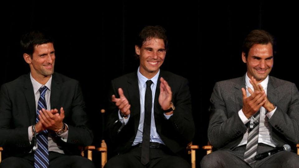 Novak Djokovic, Rafael Nadal and Roger Federer on stage during the ATP Heritage Celebration.