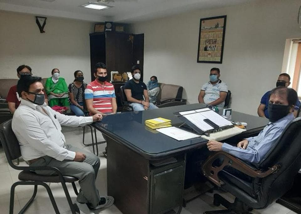 District sports officer Ravinder Singh conducting a meeting with coaches at the Guru Nanak Stadium in Ludhiana on Tuesday.