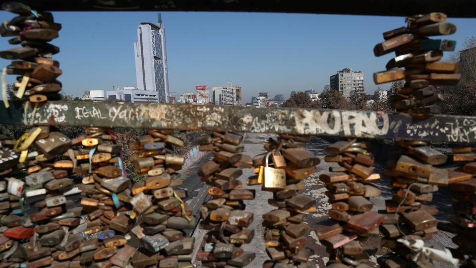 'Love locks' are seen on a bridge, with downtown Santiago in the background. Chile surpassed 40,000 cases of the new coronavirus last week amid a sharp spike in infections that has seen hospitals approach collapse in the weeks ahead of the Southern Hemisphere winter. (Ivan Alvarado / REUTERS)