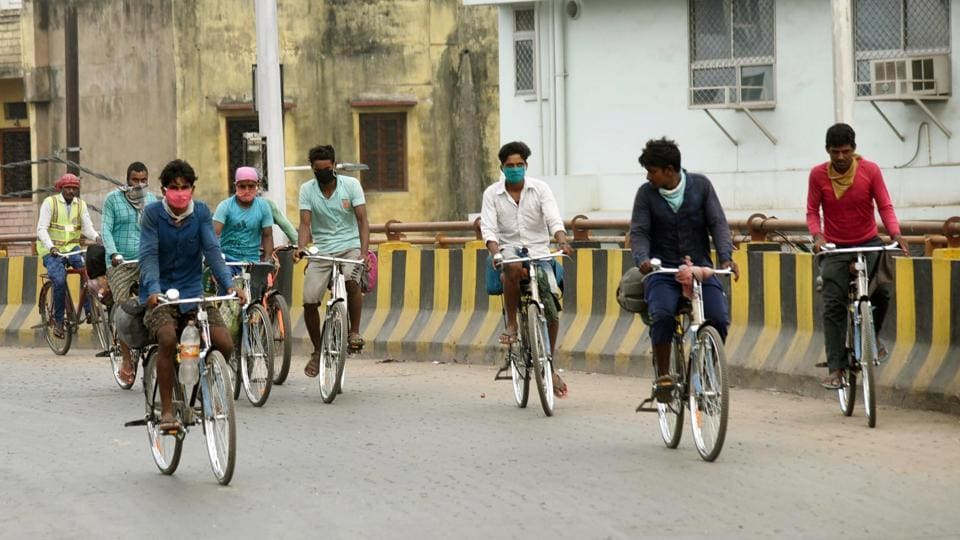 Migrants travelling on bicycles trying to reach their homes, in Patna, Bihar, on Monday.