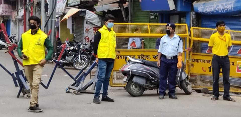 Civil Defence volunteers manning a no-entry barricade in a hotspot area in Sangam city.