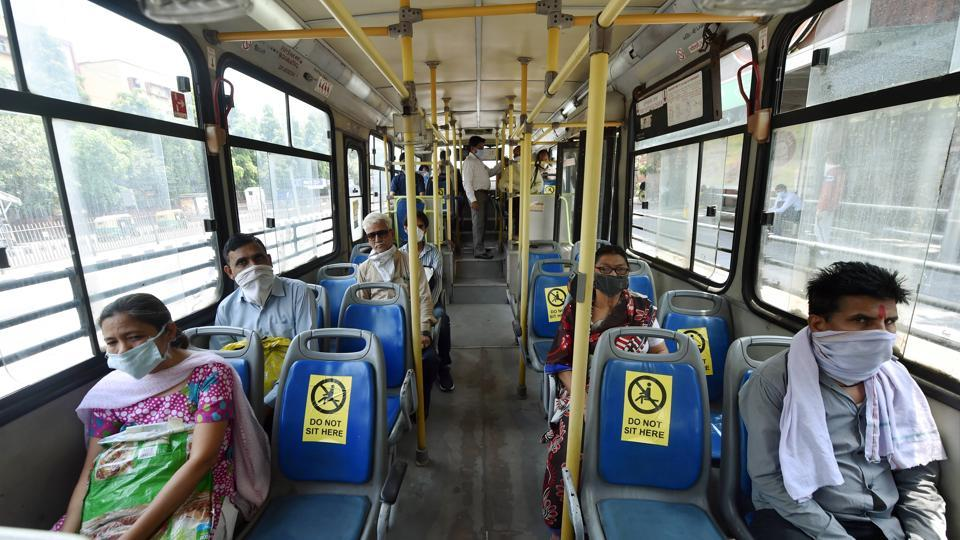 Passengers maintain social distancing while sitting in a DTC bus  during the ongoing Covid-19 lockdown, in New Delhi, Tuesday, May 19, 2020.