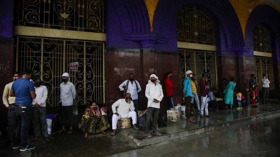 Stranded passengers wait outside Howrah railway station, which is closed due to the extremely severe cyclonic storm Amphan, in Kolkata on May 20. Amphan, a powerful cyclone has slammed ashore along the coastline of India and Bangladesh, where more than 2.6 million people fled to shelters in a frantic evacuation made all the more challenging by the coronavirus pandemic. (Bikas Das / AP)