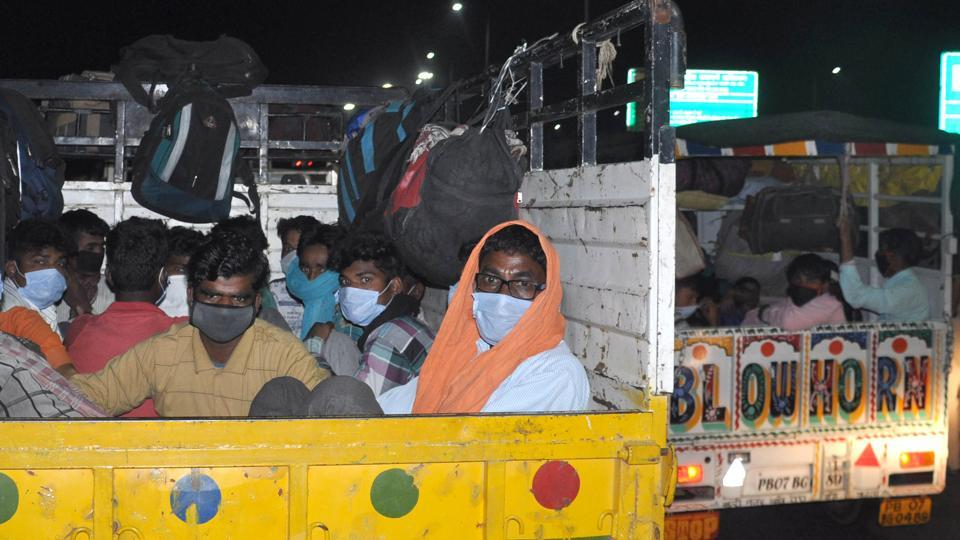 Stranded migrant workers seen in a mini truck while on a journey back home to another state amid the lockdown, near Shambhu, Punjab, India, on Tuesday, May 19, 2020.