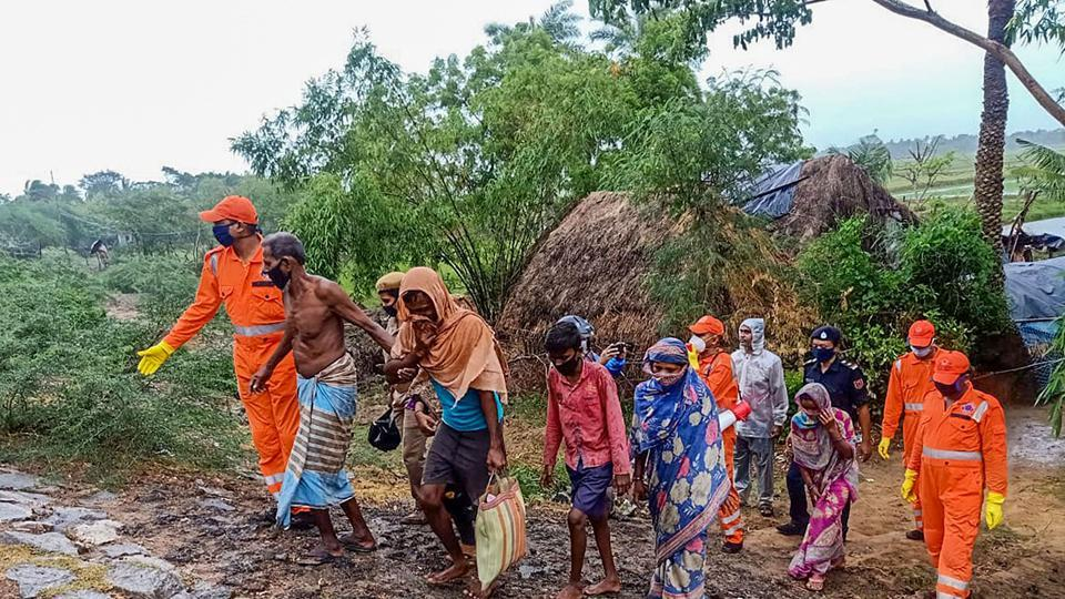 National Disaster Response Force personnel evacuate villagers residing in low-lying areas, ahead of cyclone Amphan's landfall, near Dhamra in Odisha's Bhadrak district, on Tuesday,
