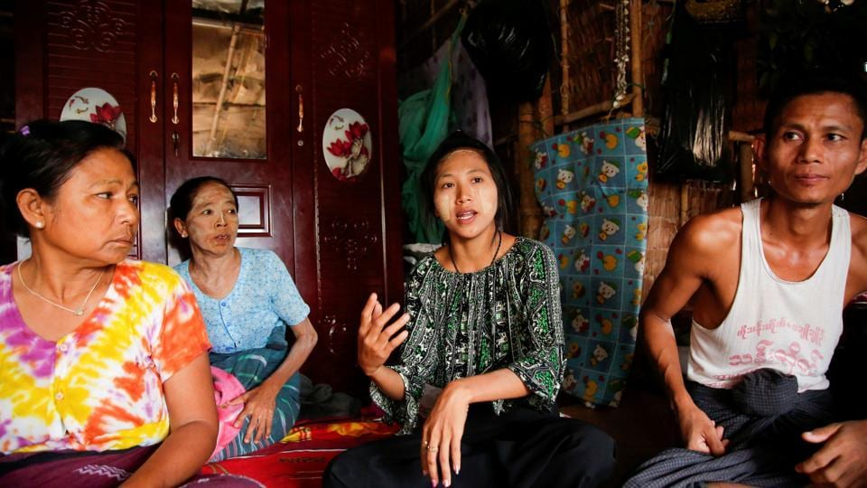 Zarchi Liwn talks to reporters in her hostel in an industrial zone on the outskirts of Yangon, Myanmar April 28, 2020. Picture taken April 28, 2020. REUTERS/Myat Thu Kyaw