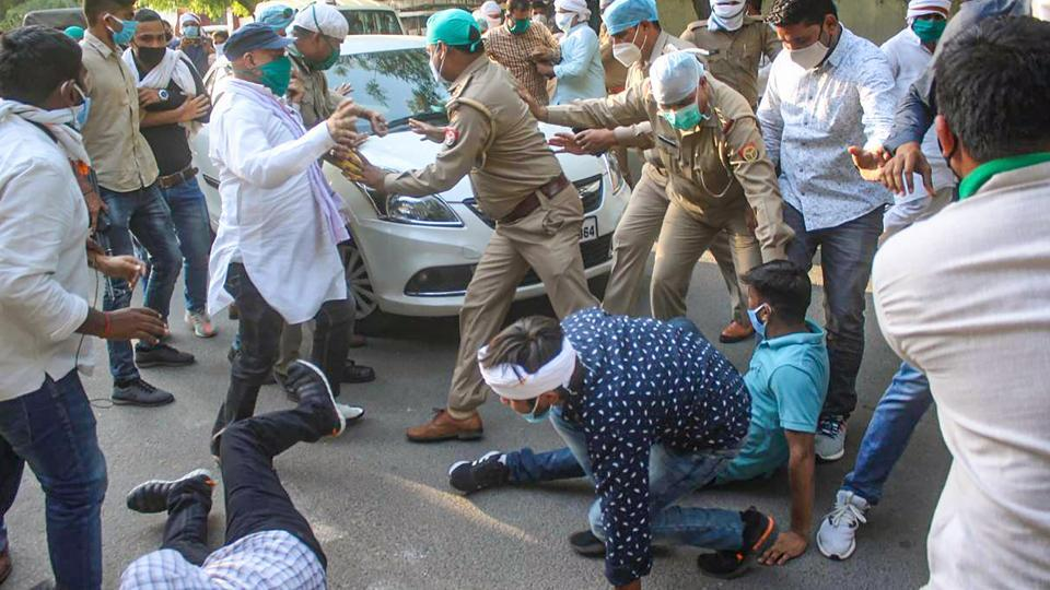 Supporters of Uttar Pradesh Congress chief, Ajay Kumar Lallu, try to block the way after the former was arrested by a team of Lucknow police.