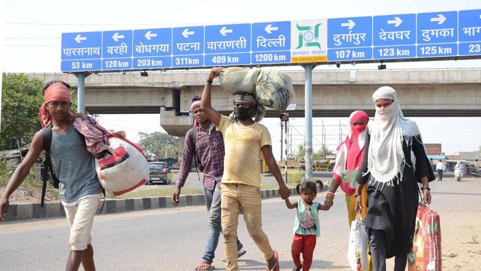 Family of migrant workers walks in Dhanbad.