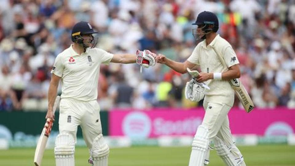 England's Chris Woakes and Stuart Broad during the match.
