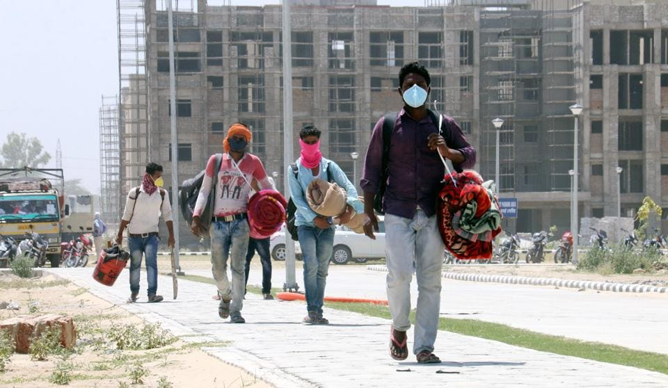 Bathinda AIIMS construction workers on their way to their hometowns amid the Covid-19 lockdown on Thursday.