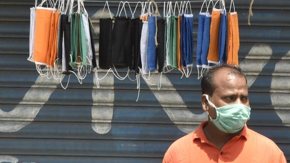A man selling colourful cotton mask at Dahisar during nation wide lockdown due to Corona virus spread in Mumbai, India, on Friday, May 15, 2020.