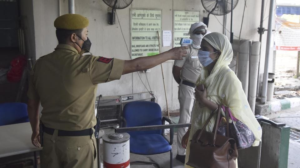 Employees working at the Delhi Secretariat undergo thermal screening on the first day of lockdown relaxations permitted by the Delhi government.