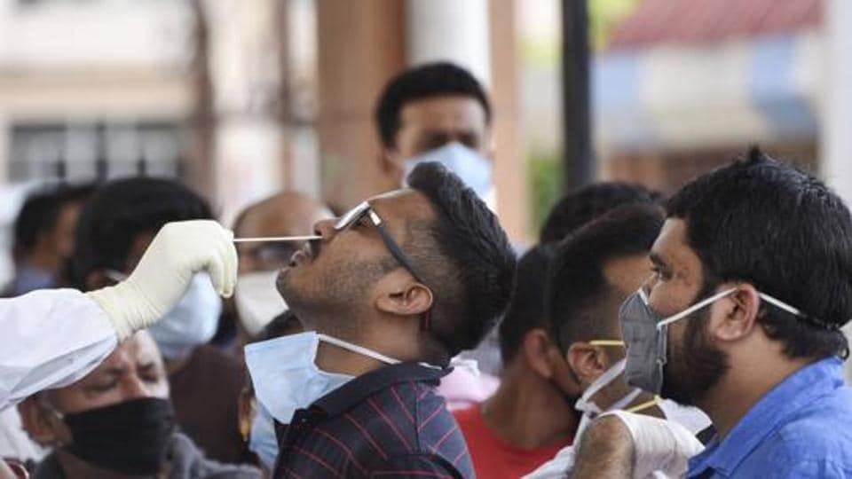 Medics collect swab samples of staff and students of Gauhati Medical College and Hospital for COVID-19 test after a PG student was tested positive for coronavirus, in Guwahati, Friday, May 8, 2020.