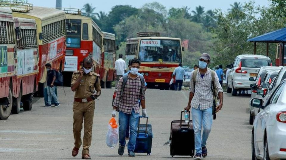Indian citizens evacuated from Maldives with a special ship INS Jalashwa are being shifted to a quarantine centre by bus, as part of a massive repatriation effort due to the COVID-19 coronavirus pandemic at the Cochin port in Kochi in the south Indian state of Kerala on May 10, 2020.