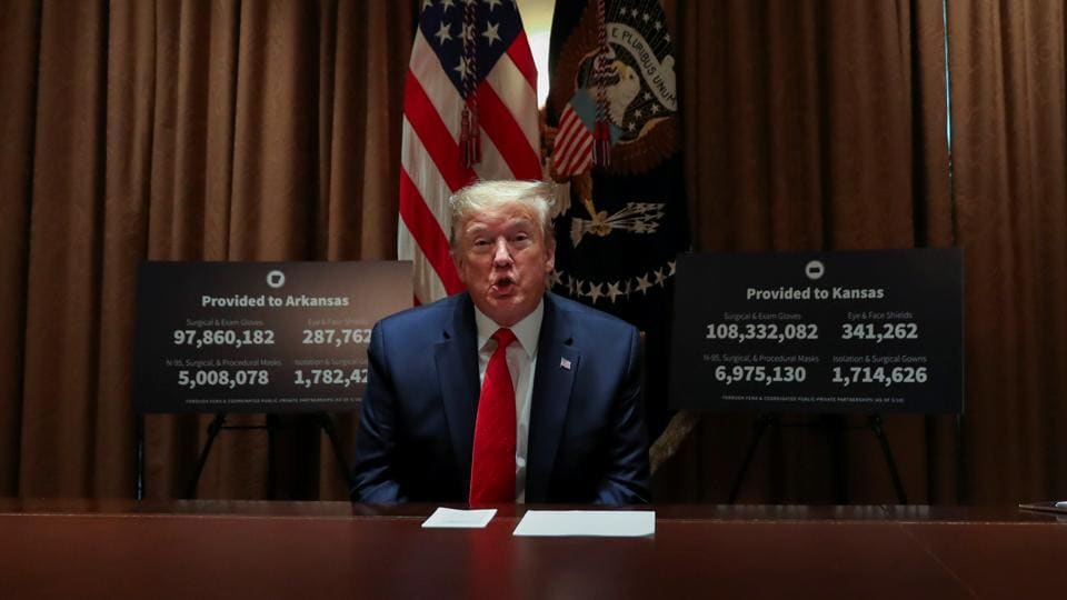 US President Donald Trump speaks about the coronavirus disease (COVID-19) pandemic response during a meeting with Arkansas Governor Asa Hutchinson and Kansas Governor Laura Kelly in the Cabinet Room at the White House in Washington, US.