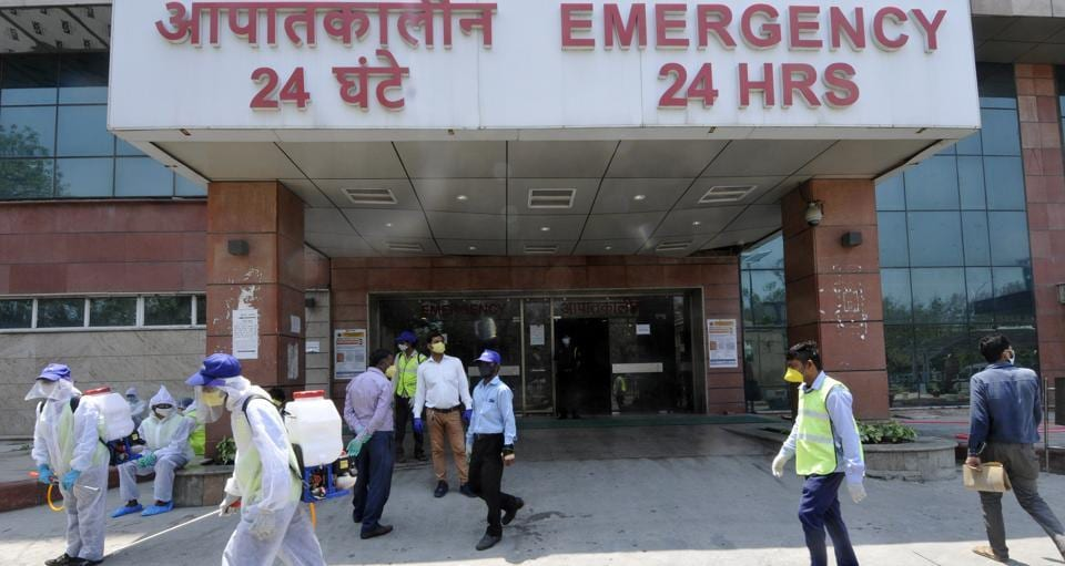 Volunteers during a disinfection drive at Child Specialist hospital during lockdown, Sector 30, in Noida, India, on Monday, April 27, 2020.
