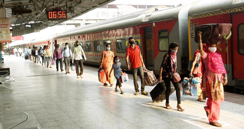 Passengers from New Delhi arrives by Rajdhani Express train at Rajendra Nagar Terminal in Patna during nationwide lockdown in the wake of the coronavirus pandemic, in Patna, India, on Tuesday, May 19, 2020.