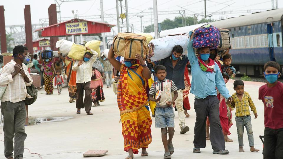 Migrants who arrived on Shramik Special trains from various states seen at Danapur Railway station in Patna.