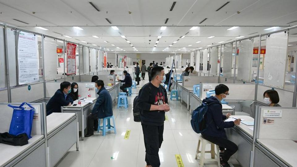 People wearing face masks to prevent the spread of the coronavirus disease  attend a job fair in Hangzhou, Zhejiang province, China.