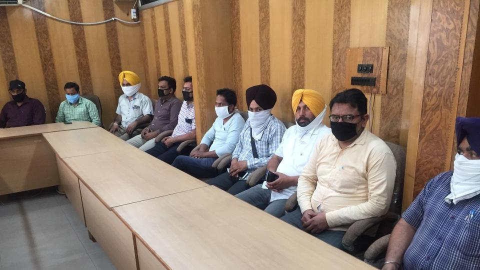 Primary teachers awaiting the distribution of coronavirus-related works at Zone A office of the municipal corporation in Ludhiana on Friday.
