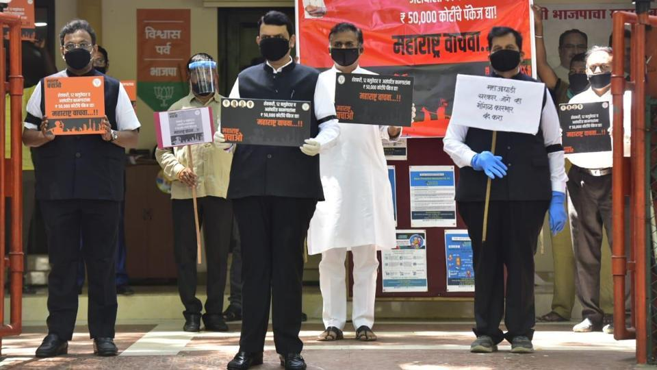 Opposition leader Devendra Fadnavis along with his party leaders participates in a 'Save Maharashtra' agitation against the state government for its failure to handle the Covid-19 pandemic at Nariman Point in Mumbai on Friday.