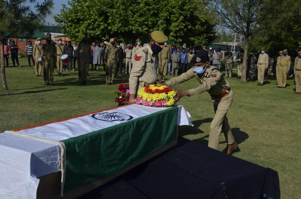 Policemen paying respect to slain policeman Anoop Singh at district Police Lines in Pulwama on Thursday.