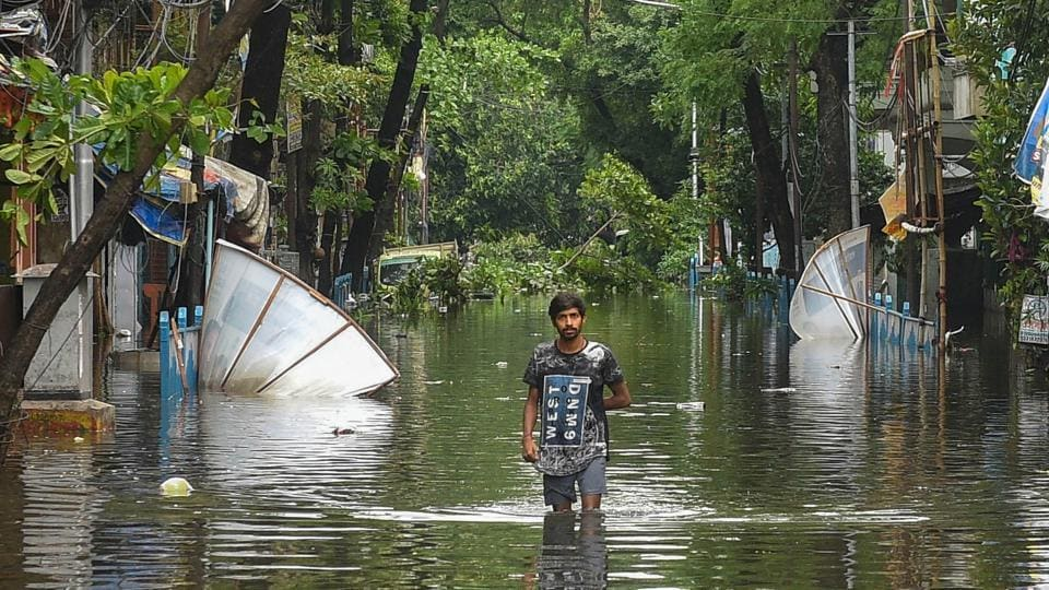 A man walks on a water-logged street after a flood in the area due to Cyclone Amphan, in Kolkata, Thursday, May 21, 2020.