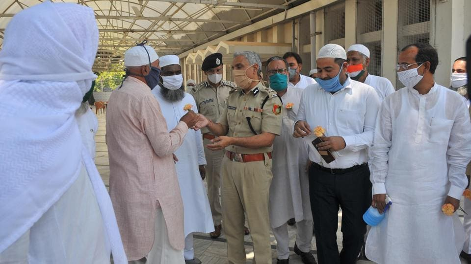 DGP Chandigarh Sanjay Baniwal along with other senior police officers greeting the leaders of the Muslim community on the last Friday of the holy month of Ramzan at Jama Masjid in Sector 20,Chandigarh.