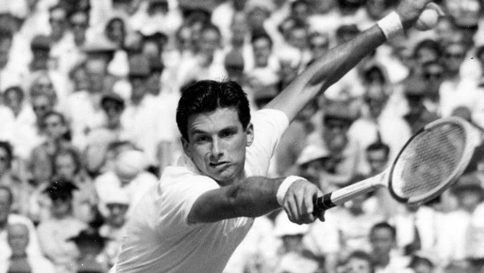 FILE - In this July 3, 1957, file photo, Australian tennis player Ashley Cooper leans forward to return service during his two-hour match against compatriot Neale Fraser at Wimbledon. Cooper, who won four Grand Slam singles titles including the Australian, Wimbledon and U.S. championships in 1958, has died. He was 83. Tennis Australia said Friday, May 22, 2020, that the former No. 1-ranked player and long-time administrator had died after a long illness. ((AP Photo/File)