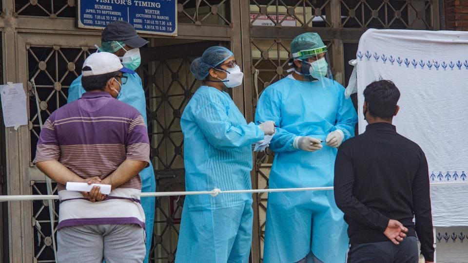 Medics attend to patients at a government hospital in New Delhi, on Monday.