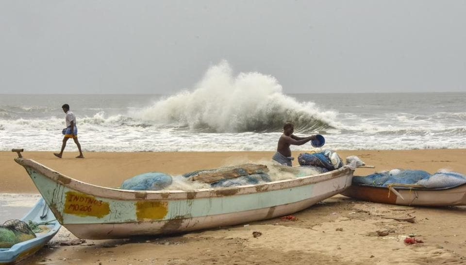 Fishermen work at a beach in the backdrop of a rough sea due to Cyclone Amphan, at Mamallapuram in Chengalpattu district, Monday, May 18, 2020/ representative.