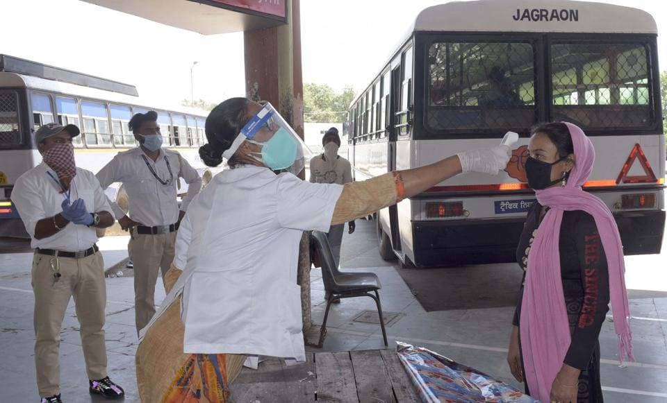 A health staff screening a passenger at the bus stand in Ludhiana on Thursday.