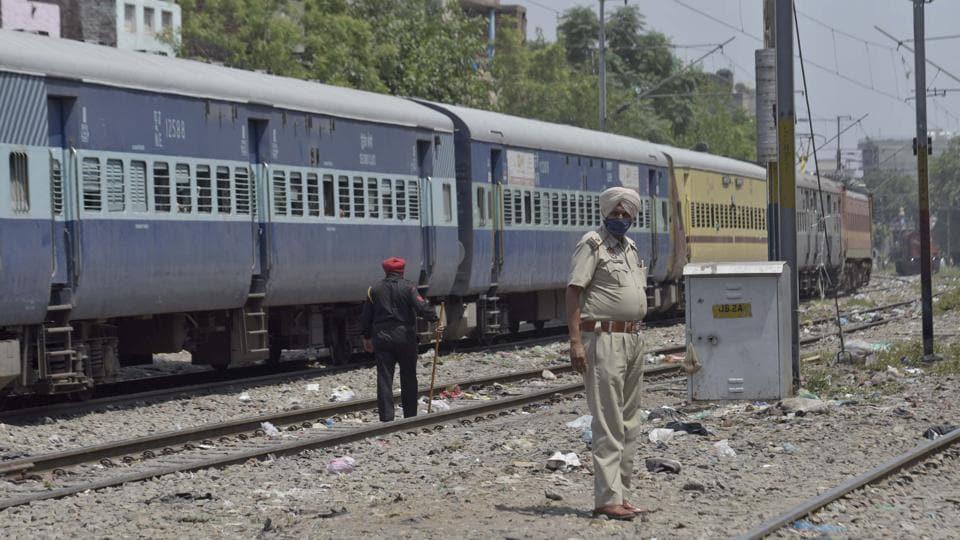 Police force deployed along railway tracks near Dukhniwaran Gurdwara to prevent the illegal boarding of Shramik Special trains in Ludhiana on Friday.
