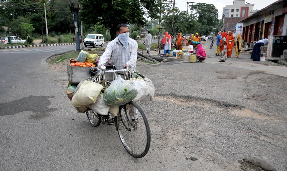 A vendor selling vegetables in Jammu on Friday.