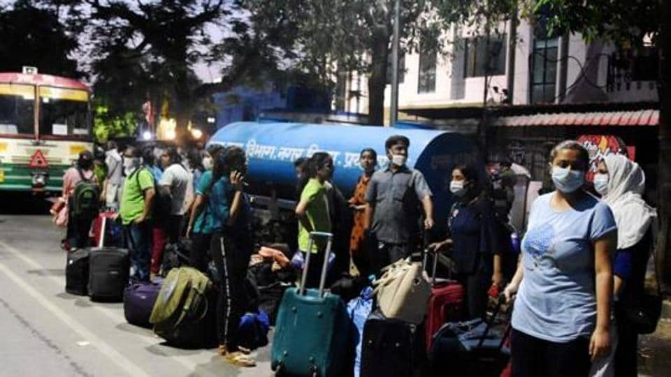 Stranded students from Kota leave for their houses after a medical checkup during a nationwide lockdown in the wake of coronavirus pandemic, at a quarantine centre in Prayagraj, Sunday, April 19, 2020.