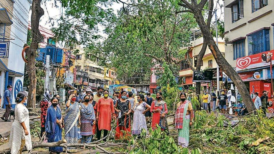 Women protest against the delay in removal of uprooted trees, prolonged power cuts and unavailability of water, in the aftermath of cyclone Amphan, at Bijoygarh in Kolkata on Saturday.