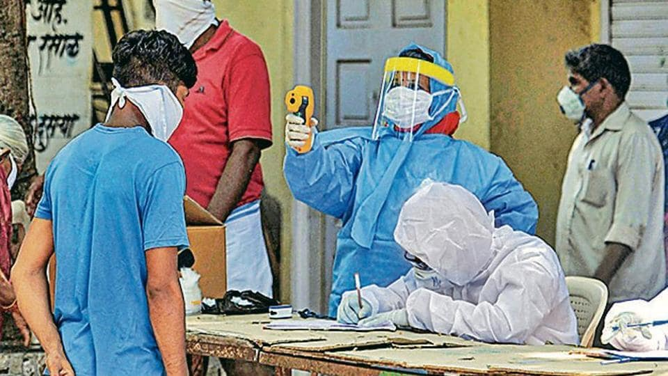 Health officials screen residents of Dharavi on Friday.