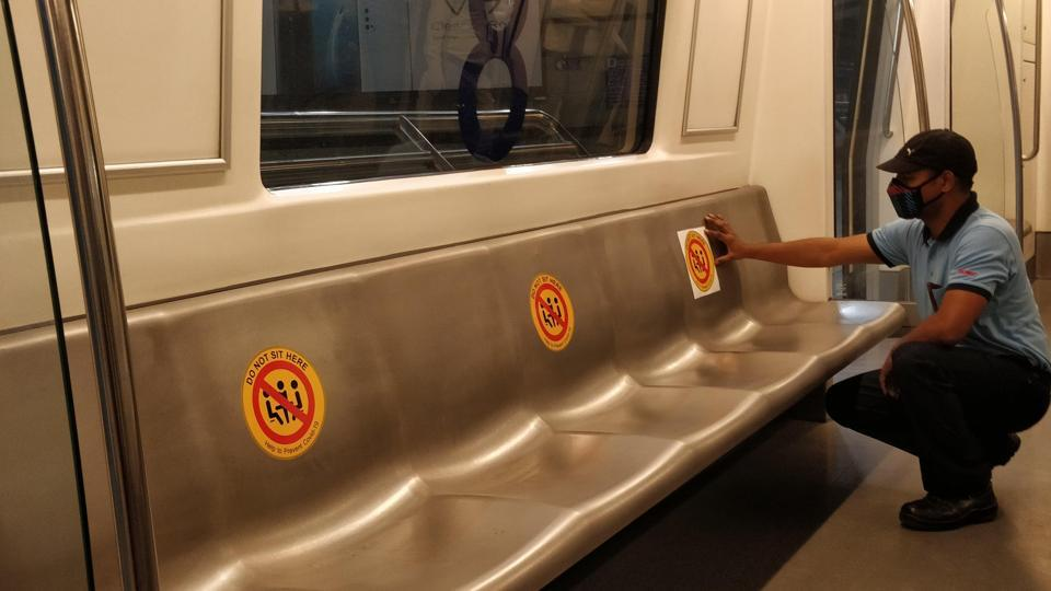 The stickers have been placed on every second seat, making sure there is enough space between two passengers.  (Photo @OfficialDMRC)
