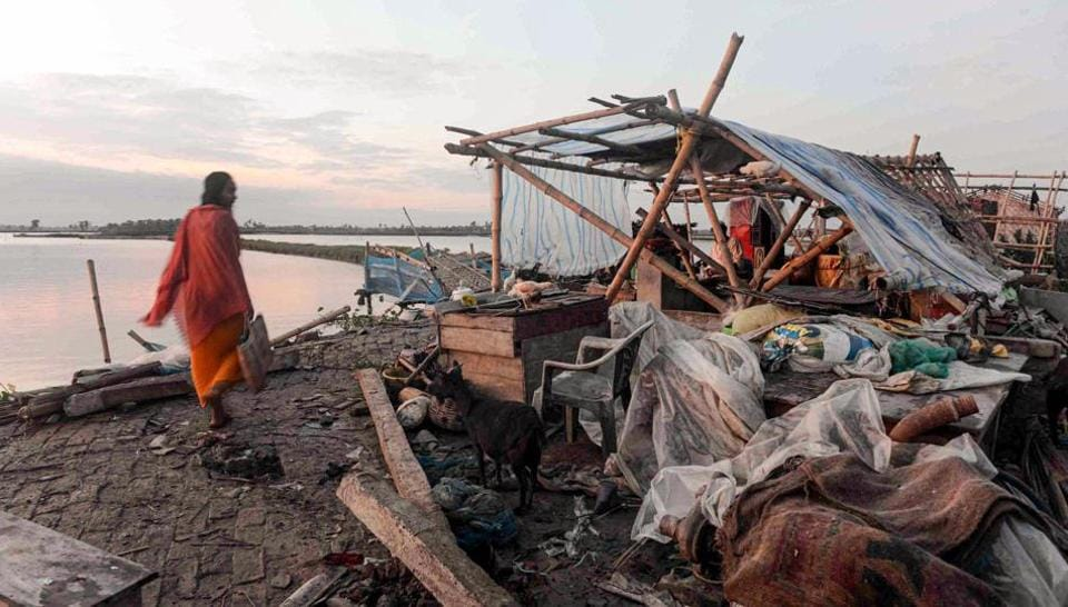 A villager walks past a damaged house, in the aftermath of cyclone Amphan, in South 24 Paraganas district of West Bengal, Friday, May 22, 2020.