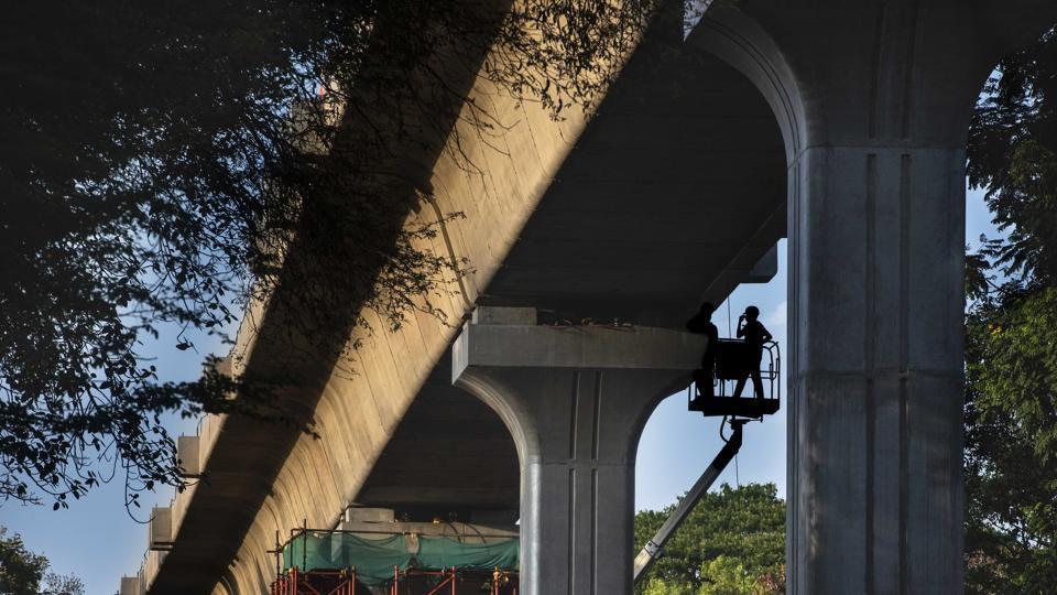 A labourer works at a metro site at Bund Garden road on Thursday.