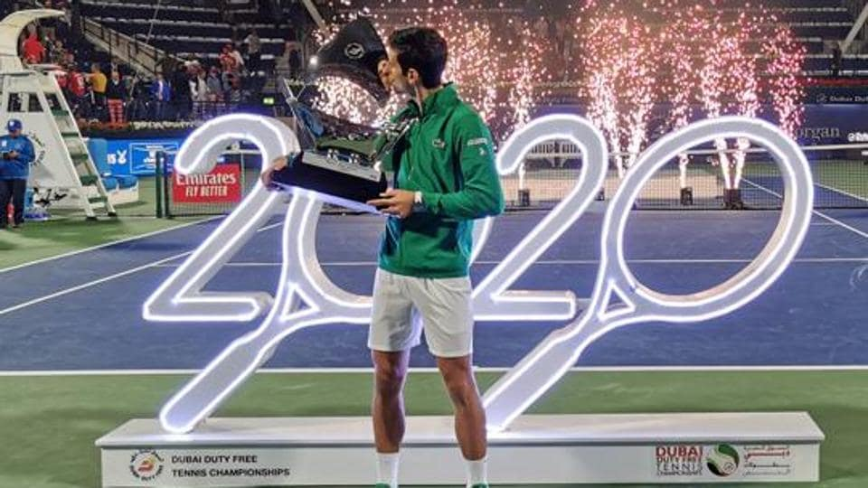 Serbia's Novak Djokovic kisses the trophy after winning the Final against Greece's Stefanos Tsitsipas.