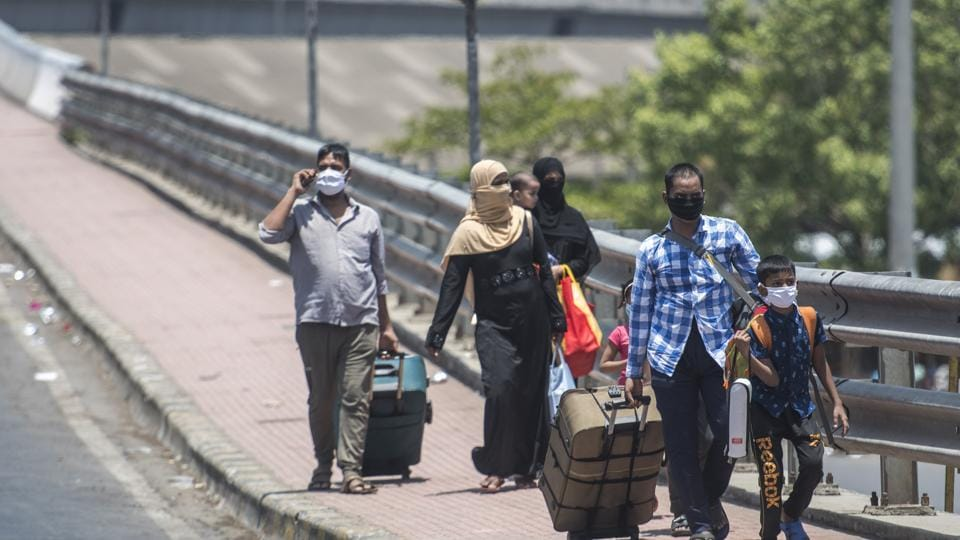 A family reach to catch a train at Lokmanya Tilak Terminus in Mumbai on Saturday.