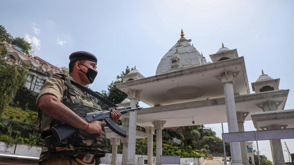 A security personnel stands guard at Katra Mata Vaishno Devi Darshani Deodi near Ban Ganga, during the ongoing nationwide COVID-19 lockdown, in Katra about 45km from Jammu, Saturday, May 23, 2020.