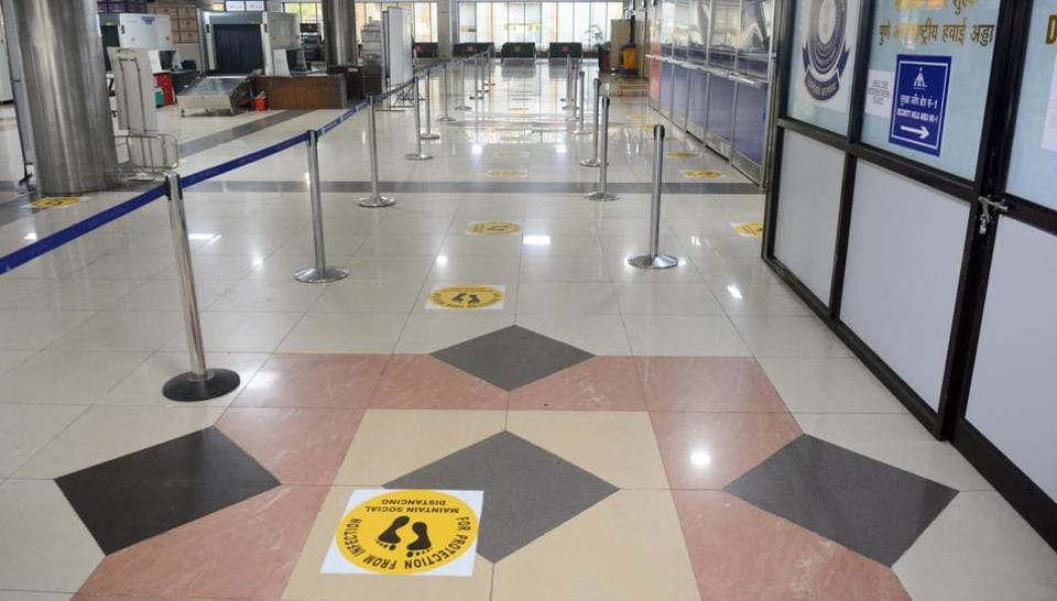 Signs on social distancing placed on the immigration office floor in Pune on Friday as domestic flights will begin operations from May 25.